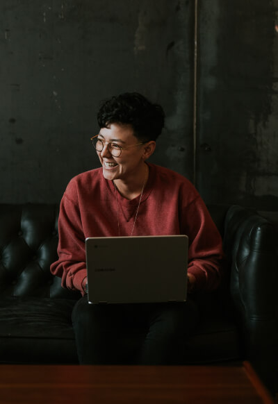 lady smiling in front of laptop